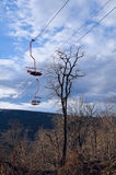 Cable car through the forest on a ridge top. The lift to the vie Royalty Free Stock Photography