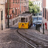 The cable car (funicular) moves uphill in Lisbon, Portugal Stock Photography