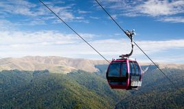 Cable car. Going downhill with mountain landscape in the background Stock Photos