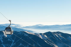 Cable car going up the mountain with beautiful scenery on background Royalty Free Stock Photography