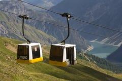 Cable car gondola in Alps mountains near Livigno lake Italy Royalty Free Stock Photos