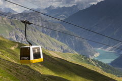 Cable car gondola in Alps mountains near Livigno lake Italy Royalty Free Stock Images