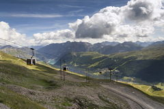 Cable car gondola in Alps mountains near Livigno lake Italy Royalty Free Stock Photo