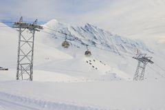 Cable car gondolas move skiers uphill at the ski resort, Grindelwald, Switzerland. Royalty Free Stock Photo