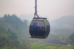 Cable Car on Green Epic Scenery Background. Cable Cabin on Ropeway on Green Landscape Royalty Free Stock Photography