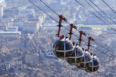 Cable car in Grenoble. Over the city. Grenoble, France - 19 February 2015. Cable car in Grenoble. Panoramic view from the Bastille Stock Image