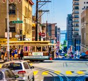 Cable car in the heart of San Francisco with many tourists on a colorful summer day. stock photography