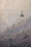 Cable car on high mountain background Stock Images