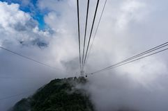 Cable car high in the mountains. Travel experience background Stock Images