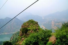 Cable car highly in mountains. Lake Yansaj. Cable car through lake Yansaj in China Stock Photos