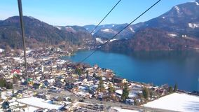 Zwolferhorn cable car over St Gilden, Austria stock video footage