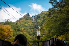 Cable car on Kachi Kachi ropeway at Lake Kawaguchiko in Autumn season, Japan. stock photos