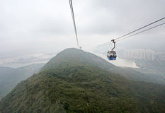Cable car in Lantau Island, Hong Kong in the fog. Ngong Ping 360 cable car on Lantau Island, Hong Kong. March 2016 Royalty Free Stock Photos