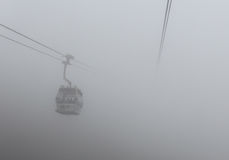 Cable car in Lantau Island, Hong Kong in the fog. Ngong Ping 360 cable car on Lantau Island, Hong Kong. March 2016 Royalty Free Stock Image