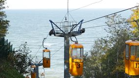 Cable car in the autumn. The cable car leads to the sea. Autumn morning stock footage