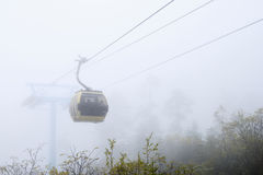 Cable car in mist Royalty Free Stock Photo