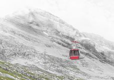Cable car at misty day. Mountain landscape on background of misty cloudy sky and a view of the cable car. City of Leukerbad-Gemmipass on 2200 meters high, canton stock photos
