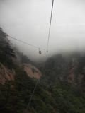 A cable car in motion in the fog Stock Image
