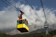 Cable car in the mountains. The cable car in Crimea Ai-Petri on a background of mountains covered with clouds Stock Image