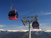Cable car in the mountains. Cable car in mountains scenery in the winter with blue sky Stock Photos