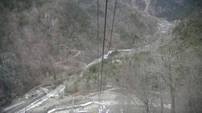 Cable car move down from Shin-hotaka peak stock footage