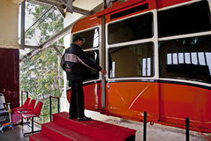Cable Car. An operator is opening the door of a ropeway car for passengers. The Rope way ride or Cable car is one of the major tourist attractions of Gangtok Royalty Free Stock Image