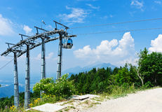 Cable car over alpine forest. Empty mountain bike elevator Royalty Free Stock Image