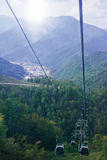 Cable car over the city and mountains Stock Photography