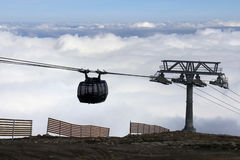 Cable Car over the clouds Stock Photos