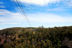 Cable-car over forest Stock Photo