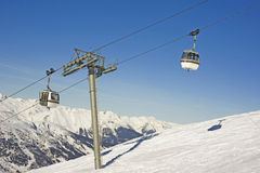 Cable car over ski slope. Cable car with two cabins going over a ski slope Stock Photo