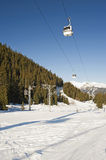 Cable car over a ski slope Stock Image
