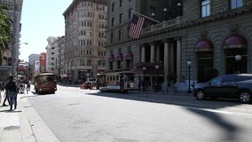 Cable Car panorama. San Francisco, California, United States - August 17, 2016: Cable cars in front of Westin St. Francis hotel along the Powell Street. panorama stock video footage