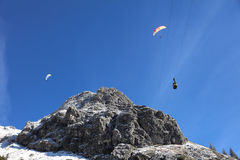 Cable Car and Paraglider Stock Photography