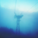 Cable car pole in fog Stock Image