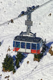 Cable car railway cabin on winter sport resort in swiss alps Stock Photography