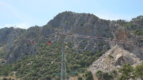 Cable car with red trailers on the background of the mountains. Antalya, Turkey. stock video footage
