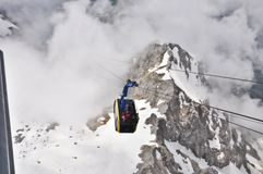 Cable car ride above clouds stock photography