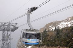 Cable car ride in the snow Royalty Free Stock Photography