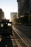 Cable Car Ride Into the Sunset. A cable car in San Francisco rides into the sunset Royalty Free Stock Image