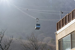 Cable car ride up to the mountains. Royalty Free Stock Image