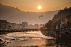 Cable car and river Isere in Grenoble, France. Cable car and river Isere at sunset in Grenoble, France Royalty Free Stock Photo
