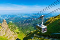 Cable car on the ropes, going to Mount Kasprowy Wierch, Poland. Beautiful view of the valley stock photos