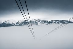 Peak to peak cable car at Whistler, Canada. Cable car running between two snow covered mountains at a ski resort Stock Images