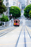 Cable car in San Francisco. A cable car of the Powell-Mason line climbs up the steep hill of Powell Avenue from Market Street to Nob Hill in the early morning Royalty Free Stock Images