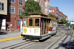 Cable car. SAN FRANCISCO - OCT 22: Vintage streetcars transport visitors along the Embarcadero and Fisherman's Wharf in San Francisco on October 22, 2012 Stock Images