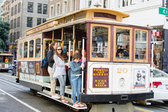 Cable Car in San Francisco. The San Francisco cable car system is the world's last manually-operated cable car system. An icon of San Francisco, California, the Stock Photo