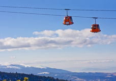 Cable car ski lift over mountain landscape Stock Photo