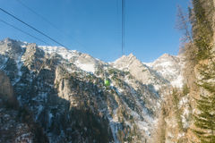 Cable car ski lift over mountain landscape Royalty Free Stock Photography