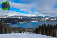 Cable car, ski slope and mountain lake Stock Image